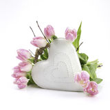 White heart with flowers. White heart of metal with flowers arround Royalty Free Stock Images