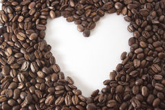White heart in the frame of coffee beans Stock Image
