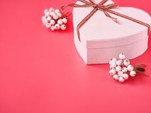 White heart gift box for Valentine`s Day on pink background. St. Valentine day concept royalty free stock photos