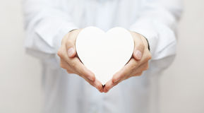 White heart in hands Royalty Free Stock Photos