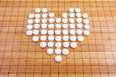 A white heart in a japanese go board Stock Images