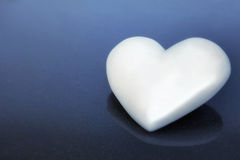 White heart laying on mirror granit Stock Image