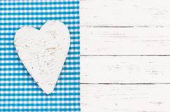 Baby shower greeting card background with heart and blue checked fabric for a boy. White heart on light blue background and copy space for baby shower it a boy stock image