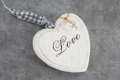 White heart make with wood under grey background Royalty Free Stock Photo