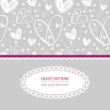 White heart pattern on grey background with white label and text Stock Photos