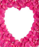 White heart and pink rose petals Royalty Free Stock Photography