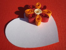 White heart with quilling flower on red background Stock Photos
