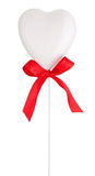 White heart and red ribbon with a bow Isolated on white Stock Photos