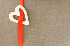 White heart. On red tape gray  background Royalty Free Stock Images