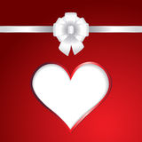 White heart and ribbon bow on red background Royalty Free Stock Photography