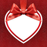 White heart with ribbon on red background Royalty Free Stock Photos