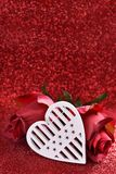 White heart and roses on red glitter background Royalty Free Stock Photo