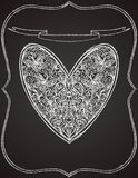 White heart shape on black chalk board Royalty Free Stock Photo