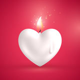 White heart shape candle on red background Stock Photos