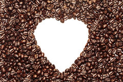 White heart shape on coffee bean background. White heart shape on brown coffee bean background royalty free stock photo