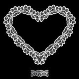 White Heart shape is made of lace doily isolated on black   Royalty Free Stock Photos