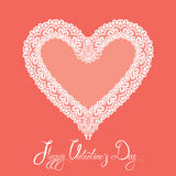 White Heart shape is made of lace doily on pink background, Holi Royalty Free Stock Photo