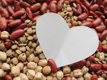 Closeup of White Heart shape on Raw Red Beans, lentils and chick Royalty Free Stock Photos