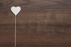 White heart shape on stick Royalty Free Stock Photography