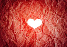 White heart shape on vibrant paper background Stock Image