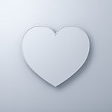 White heart shape on white wall background with shadow, valentines day background Stock Image