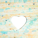 White heart shaped mousepad on wooden background Stock Images