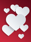 White Heart Shapes Against Red Background Royalty Free Stock Photos