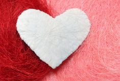 White heart. Valentine. White heart on a pink and red background Royalty Free Stock Photography