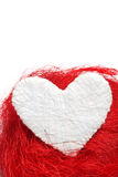 White heart. Valentine. White heart on a red background Royalty Free Stock Photography