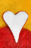 White heart. Valentine. White heart on a yellow and red background Royalty Free Stock Photos