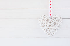 White heart on white wooden background. Valentines day  background. Copy space Stock Photo