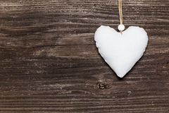 White heart on wooden board Stock Image