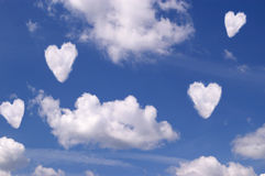 White hearts. White clouds hearts on blue sky Stock Photography