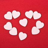 White  hearts. On red background Stock Photo