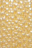 White hearts background. The beads in the shape of heart Royalty Free Stock Images