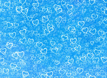 White hearts background on a blue winter backgrounds. Love textu Stock Photo