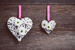 White hearts on old wooden background Stock Photos