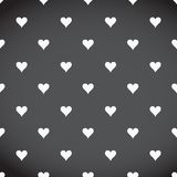 White hearts patter over a black background Royalty Free Stock Photos