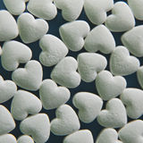 White hearts pills. White hearts background macro pills stock photos