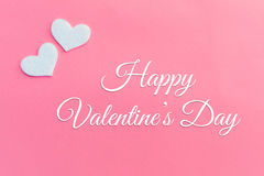 White hearts on pink background with Valentines day greeting Royalty Free Stock Image