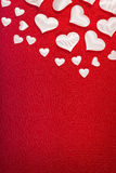 White hearts on red background Royalty Free Stock Image
