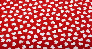 White Hearts on Red Cloth. A pattern of red hearts on red cloth Royalty Free Stock Image