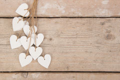 White hearts on a scaffolding wooden background Royalty Free Stock Image