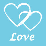 White hearts and the text love on a blue background Stock Images