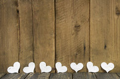 White hearts on a wooden old rustic background. royalty free stock photography