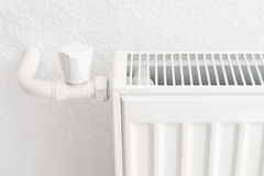 White heating radiator in an apartment. Detail shot Stock Images