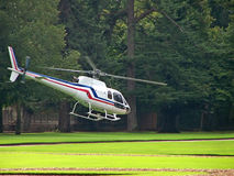 White Helicopter. A white helicopter on a field stock photography