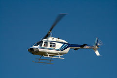 White helicopter in flight Stock Photography