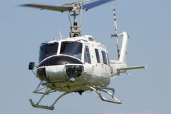 White helicopter flying Royalty Free Stock Photography