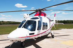 White helicopter. Parked on airfield Royalty Free Stock Photo